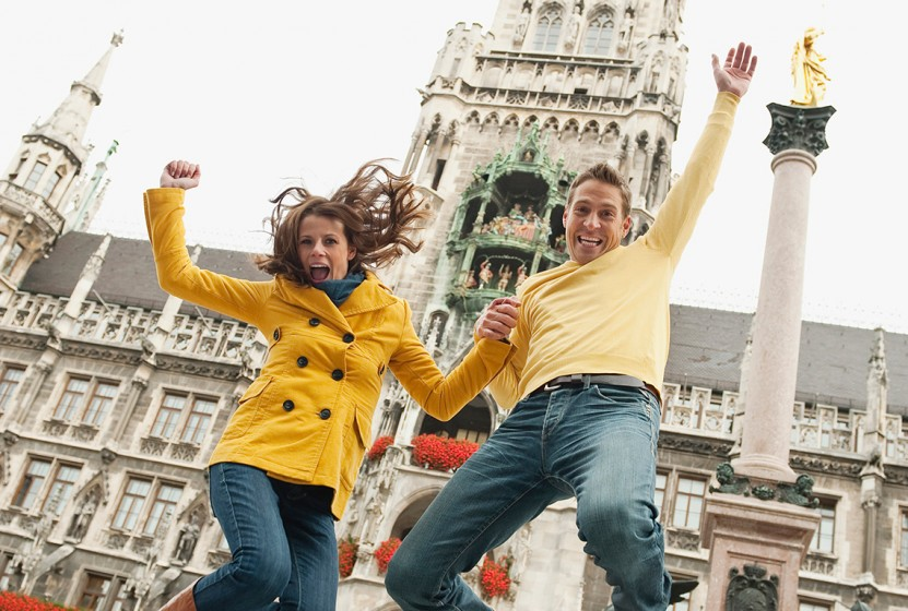 Germany_Munich_Marienplatz_Couple-jumping_GettyImages-101744274