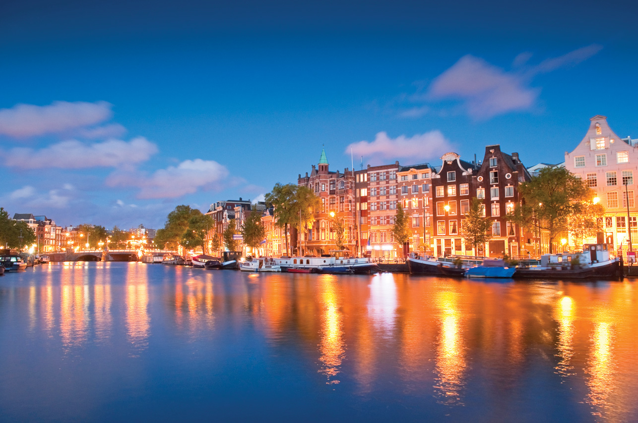 Visit canals in Amsterdam this winter.
